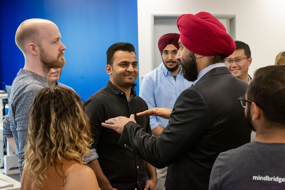The Honourable Navdeep Bains, Minister of Innovation, Science and Economic Development, speaks with MindBridge Ai staff Chrissy Bridges, Shahzeb Khowaja, and Rob Peace